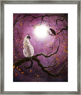 Dreaming Of A Raven Framed Print by Laura Iverson