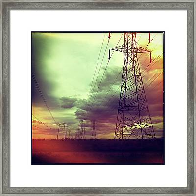 Electricity Pylons Framed Print by Mardis Coers