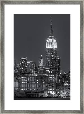 Empire State And Chrysler Buildings At Twilight II Framed Print by Clarence Holmes