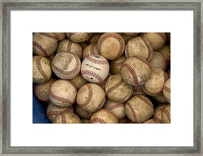 One Clean Baseball Sitting In A Pile Framed Print by Phil Schermeister