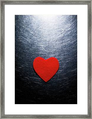 Red Felt Heart On Stainless Steel Background. Framed Print by Ballyscanlon