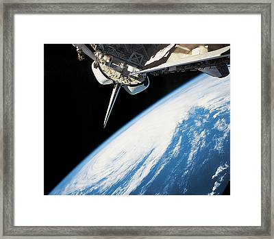 Space Shuttle In Outer Space Framed Print by Stockbyte