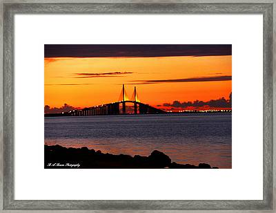 Sunset Over The Skyway Bridge Framed Print by Barbara Bowen