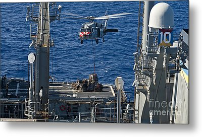 An Mh-60s Sea Hawk Delivers Supplies Metal Print by Stocktrek Images