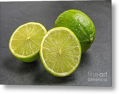 Limes On A Slate Plate Metal Print by Palatia Photo