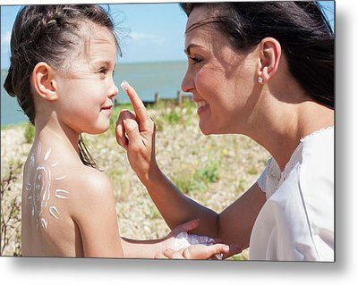 Mother Applying Suncream To Daughter Metal Print by Ian Hooton