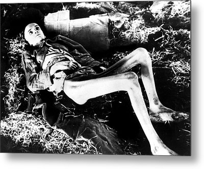 A Victim Of A German Concentration Metal Print by Everett