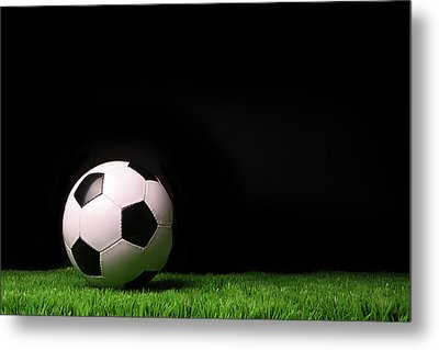 Soccer Ball On Grass Against Black Metal Print by Sandra Cunningham