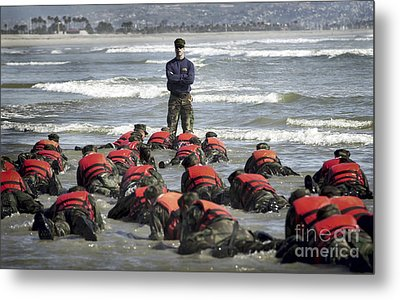A Navy Seal Instructor Assists Students Metal Print by Stocktrek Images