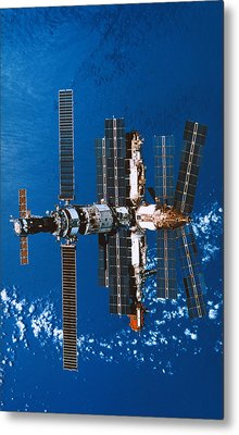 A Space Station Orbiting In Space Metal Print by Stockbyte