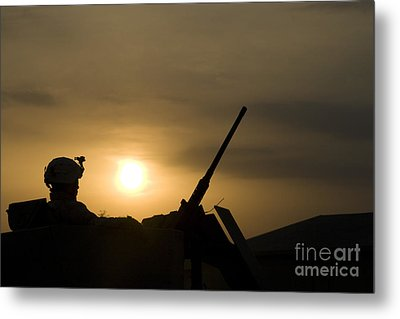 A Us Soldier Mans His .50 Caliber While Metal Print by Terry Moore
