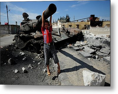 A Young Syrian Boy Plays On The Turret Metal Print by Andrew Chittock