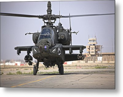 An Ah-64 Apache Helicopter Returns Metal Print by Terry Moore