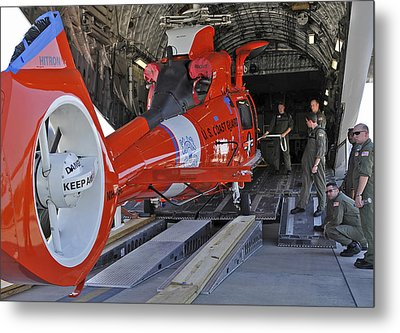 An Aircrew Loads A Coast Guard Hh-65 Metal Print by Stocktrek Images