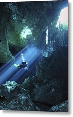 Diver Silhouetted In Sunrays Of Cenote Metal Print by Karen Doody