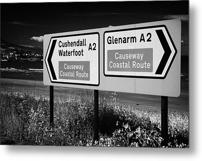 Signposts For The Causeway Coastal Route At Carnlough Between Cushendall And Glenarm County Antrim Metal Print by Joe Fox