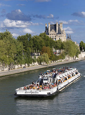 Sightseeing Boat On River Seine To Louvre Museum. Paris Poster by Bernard Jaubert