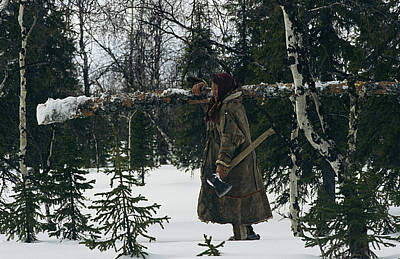 A Pregnant Nenets Woman Carries A Small Print by Maria Stenzel