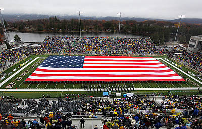 Knights Photograph - Army An American Flag Spans Michie Stadium by Associated Press