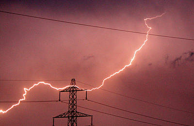 In A Row Photograph - Lightning Hitting An Electricity Pylon by Peter Lawson
