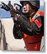 A Member Of The Chinese Peoples Metal Print by Stocktrek Images