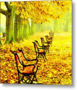 Row Of Red Benches In The Park Metal Print by Jaroslaw Grudzinski