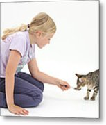 Girl Feeding Kitten From A Spoon Metal Print by Mark Taylor