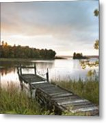 A Dock On A Lake At Sunrise Near Wawa Metal Print by Susan Dykstra