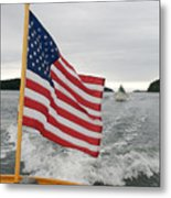 A Flag Waves On The Stern Of A Maine Metal Print by Heather Perry