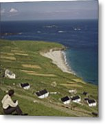 An Irishman Overlooks Cottages That Metal Print by Howell Walker