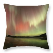 A Brilliant Display Of Aurorae Throw Pillow by Paul Nicklen