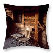 Firewood And A Chair On The Porch Throw Pillow by Joel Sartore