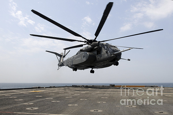 Military Photograph - An Mh-53e Sea Dragon Prepares To Land by Stocktrek Images