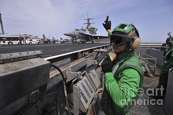 Uss Enterprise Photograph - Aviation Boatswain's Mate Signals by Stocktrek Images