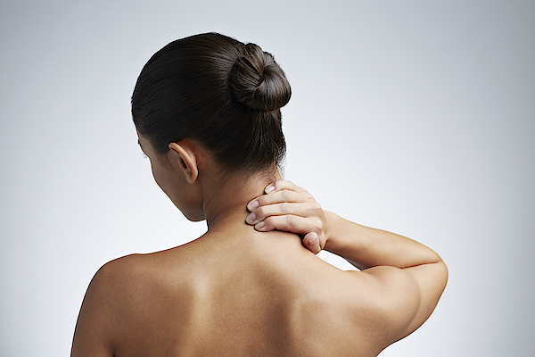 Close Up Of Woman Having Neck Pain Photograph by Klaus Vedfelt