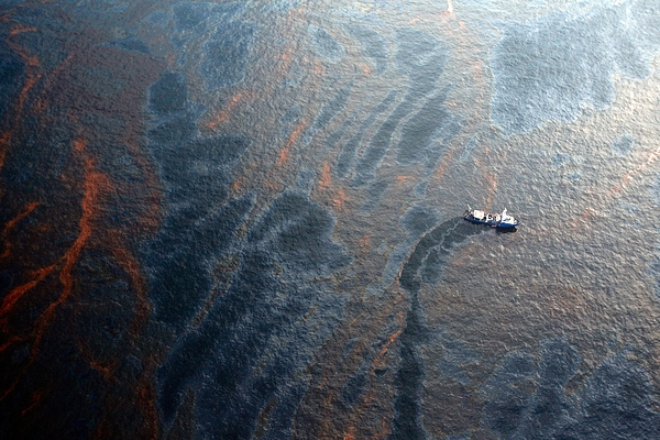 Coast Guard Attempts Burning Off Oil Leaking From Sunken Rig Photograph by Chris Graythen