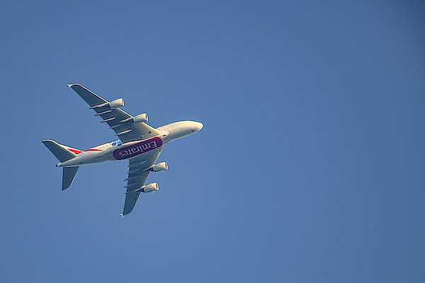 Emirates Airline Airbus A380 Flying High Up In The Air. Photograph by Sjo