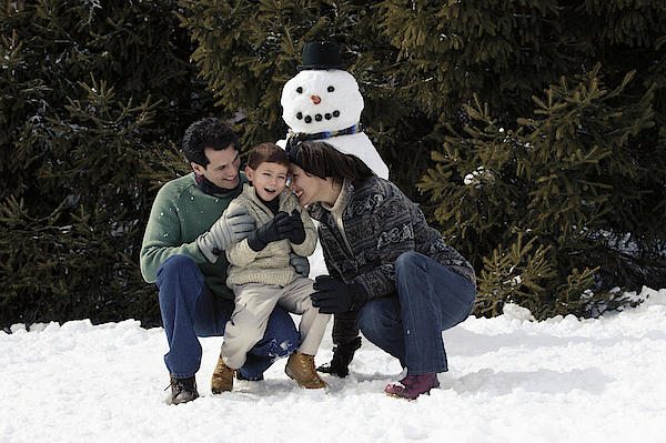 Family With Snowman 1 Photograph by Comstock Images