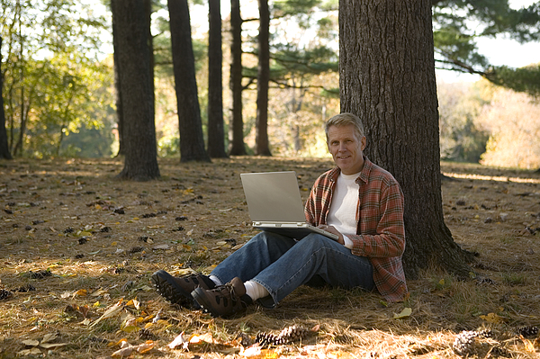 Man Using Laptop Outdoor 1 Photograph by Comstock Images
