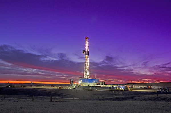 Oil Fracturing Drilling Rig At Dusk Photograph by Rich LaSalle