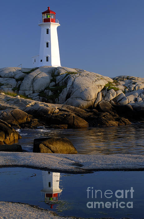 Lighthouse Photograph - Peggys Cove Lighthouse by Norman Pogson