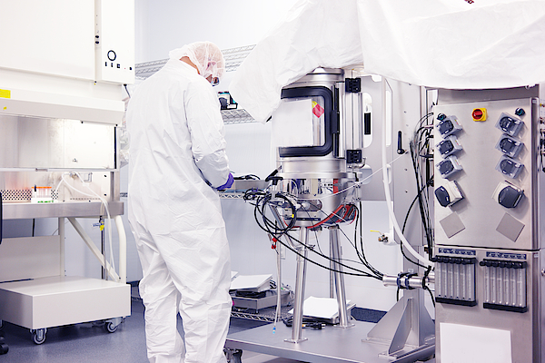 Scientist Working In A Cleanroom Photograph by Reptile8488