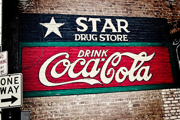 Sign Photograph - Star Drug Store Wall Sign by Scott Pellegrin