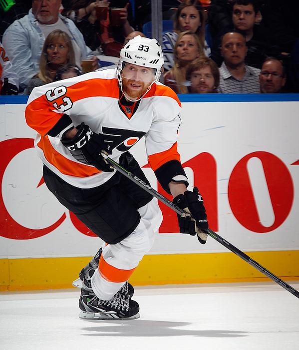 Philadelphia Flyers V New York Islanders Photograph by Bruce Bennett