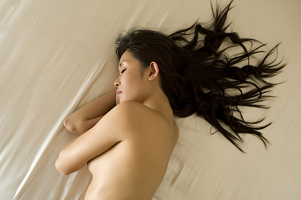 Naked Woman Sleeping On Bed Photograph by B2M Productions
