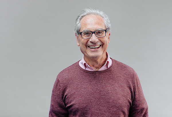 Portrait Of A Smiling Senior Business Man Photograph by Serts