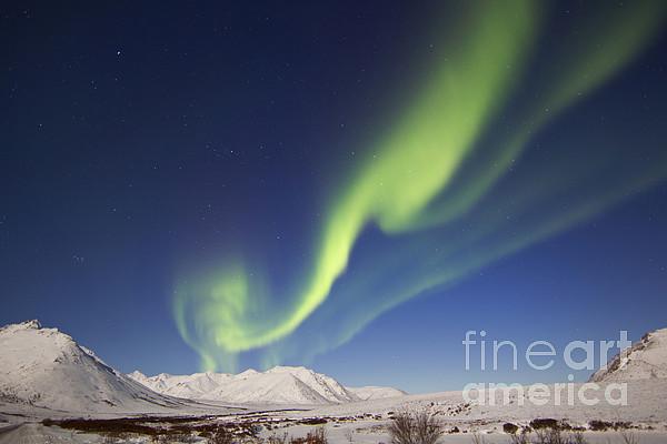 Atmospheric Mood Photograph - Aurora Borealis With Moonlight by Joseph Bradley