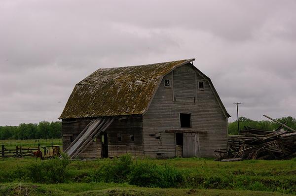 Barn Photograph - A Barn In Northern Montana by Jeff Swan