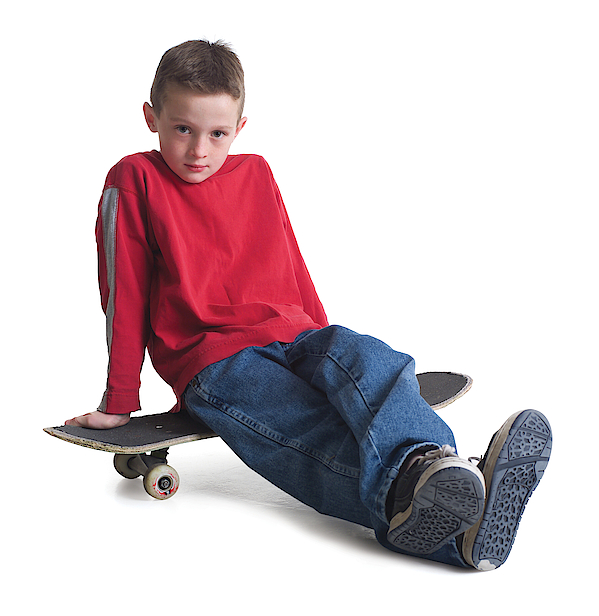 A Caucasian Boy In Jeans And A Red Sweater Sits On His Skateboard And Smiles Slightly Photograph by Photodisc