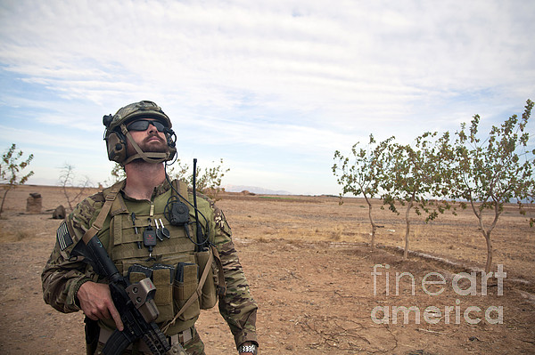 Afghanistan Photograph - A Coalition Force Member Looks For Air by Stocktrek Images